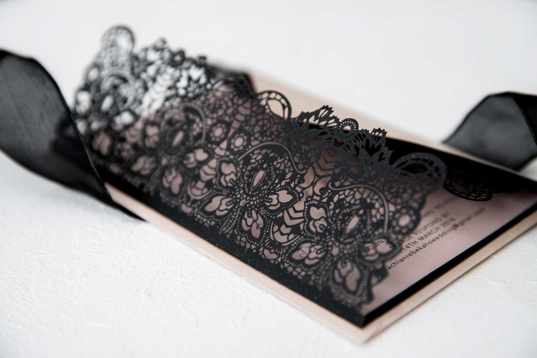 black and dusty pink laser-cut wedding invitation