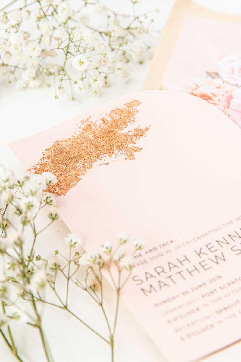 blush pink rose gold foil wedding invitation close up