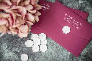 white wax seal burgundy envelope