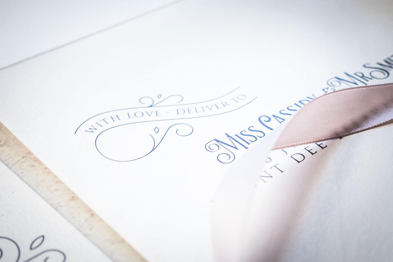 white and navy envelope