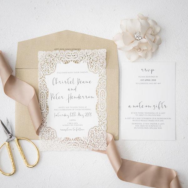 ivory and gold laser-cut wedding invitation