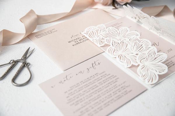 white and blush pink flower laser-cut wedding invitation