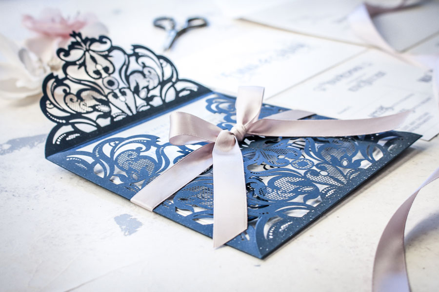 navy and champagne laser-cut wedding invitation