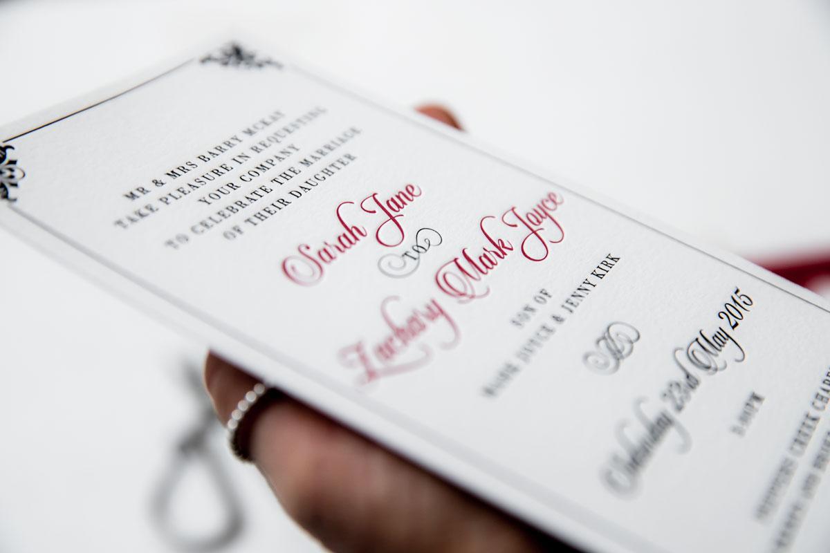 black and red letterpress wedding invitation