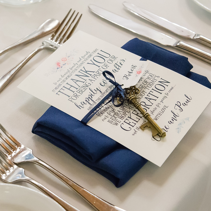 navy thank you card with key at wedding reception