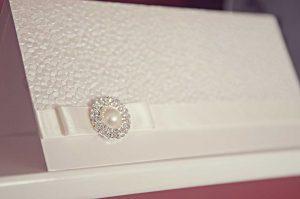 white and ivory pebble wedding invvitation
