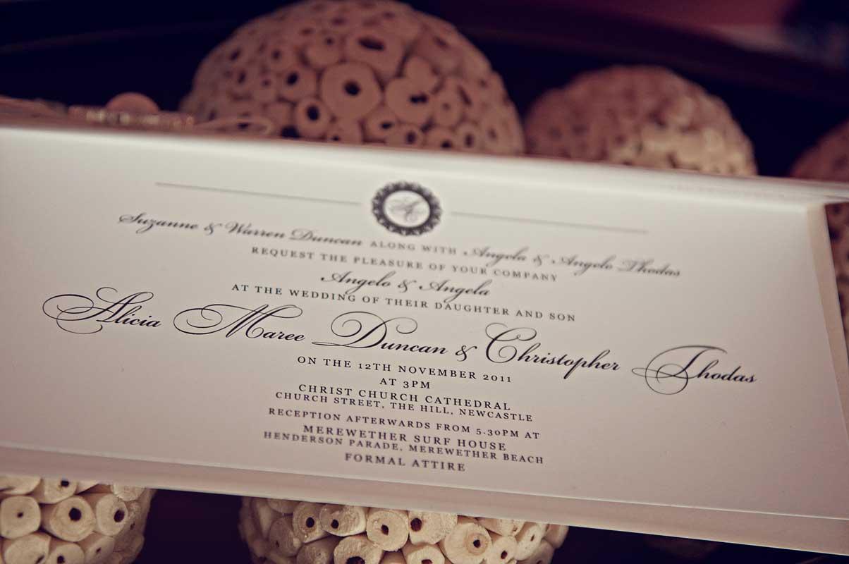 white and ivory pebble wedding invvitation closeup