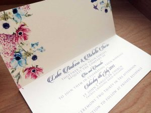 floral wedding invitation closeup