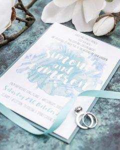 aqua coastl palm leaves wedding invitation