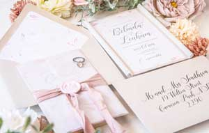 wax seal blush wedding invitation