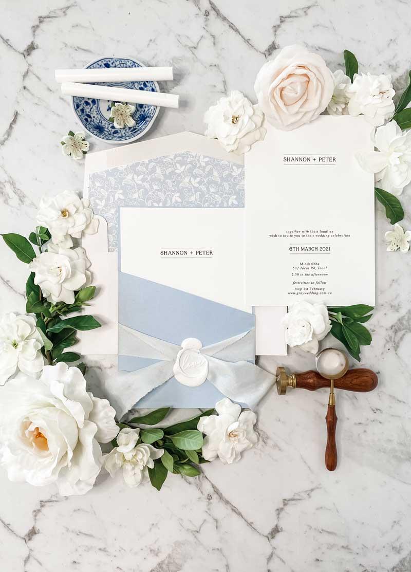 light blue diecut pocket wedding invitation suite
