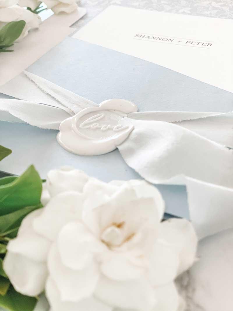 light blue diecut pocket wedding invitation wax seal
