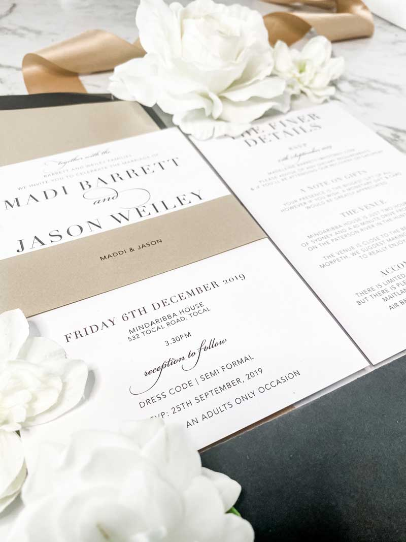 black and neutral wedding invitation closeup