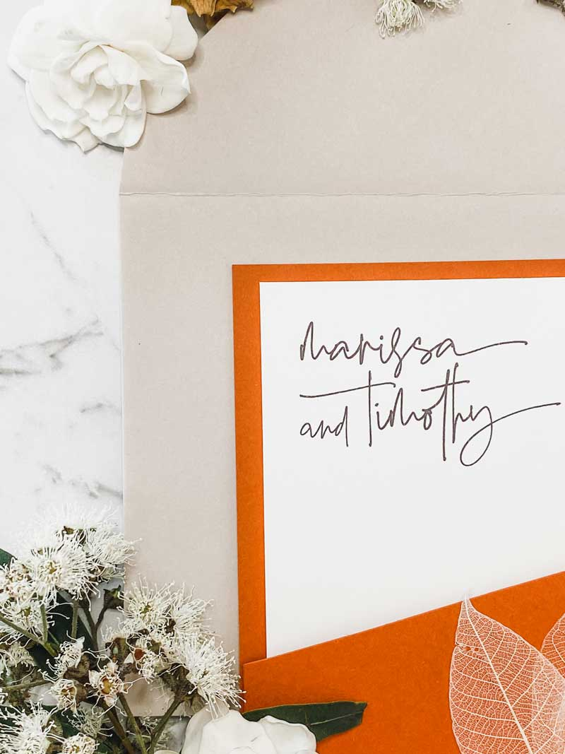 terracootta diecut wedding invitation closeup