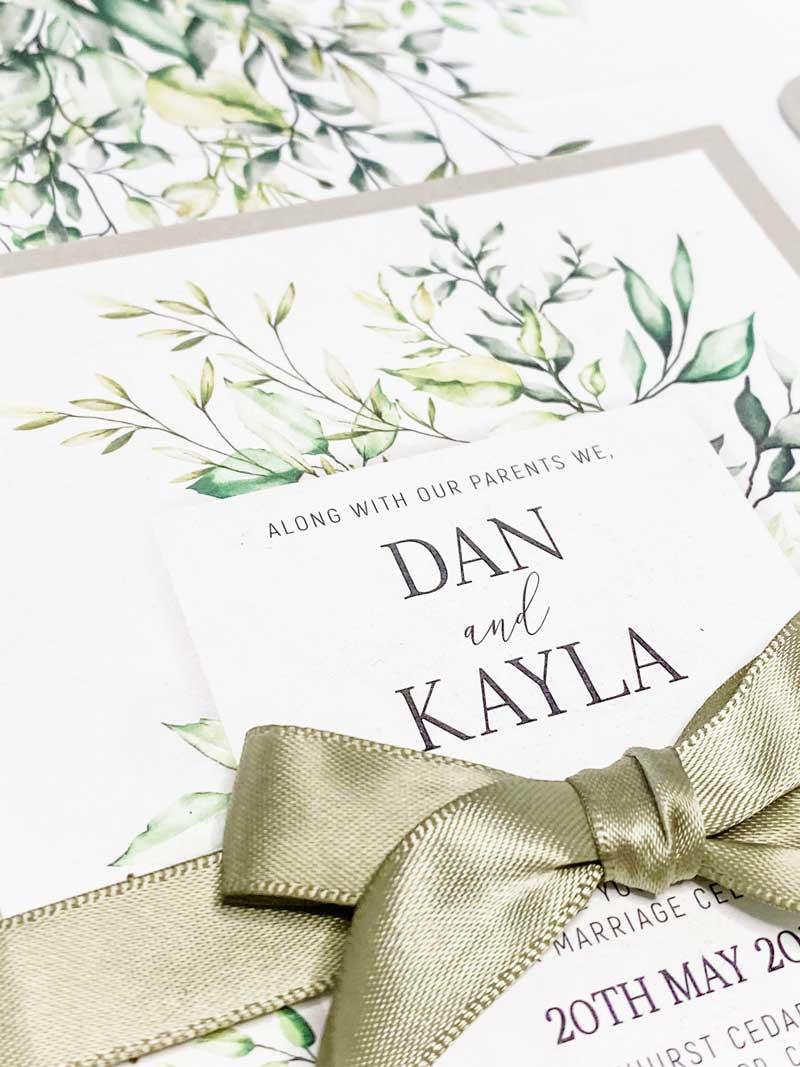 botanic wedding invitation with olive ribbon green beige