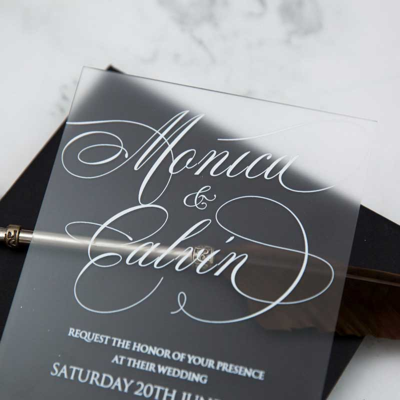 frosted acrylic black and white wedding invitation closeup