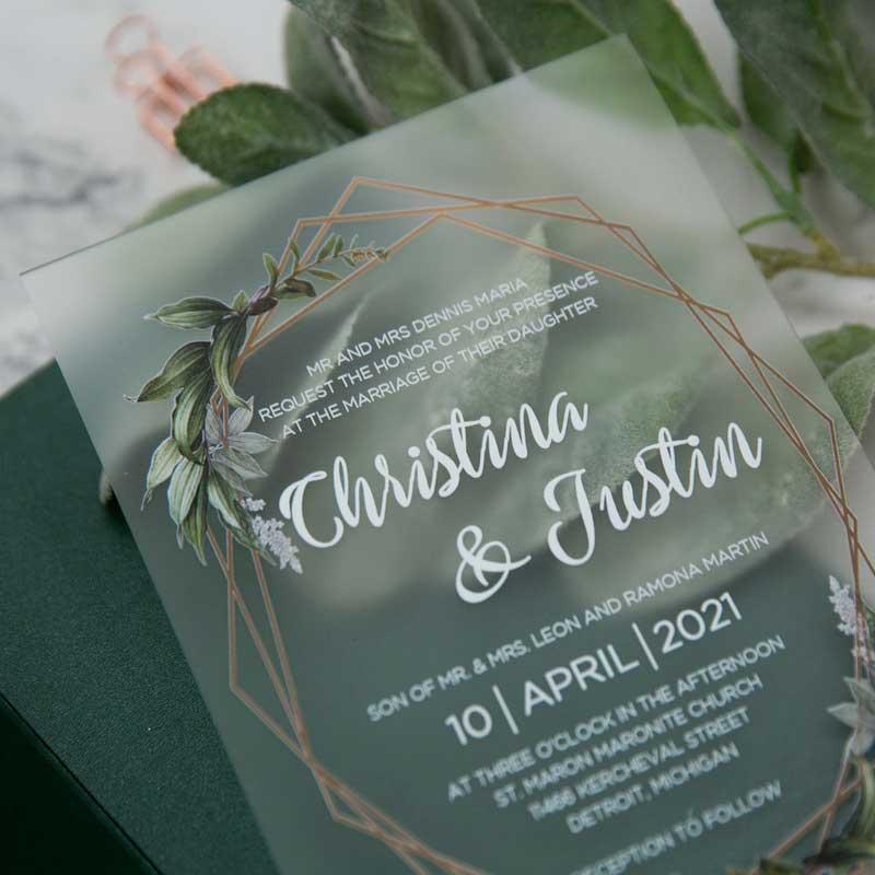 frosted acrylic botanical wedding invitation closeup