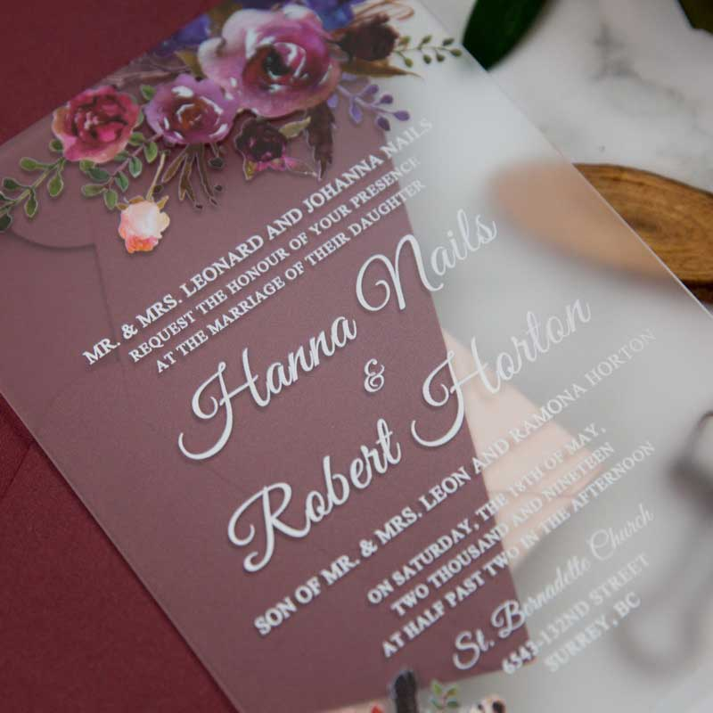 frosted acrylic floral wedding invitation closeup