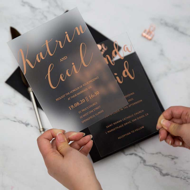 frosted acrylic black and gold wedding invitation closeup
