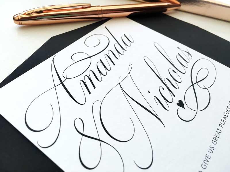 black and white script wedding invitation