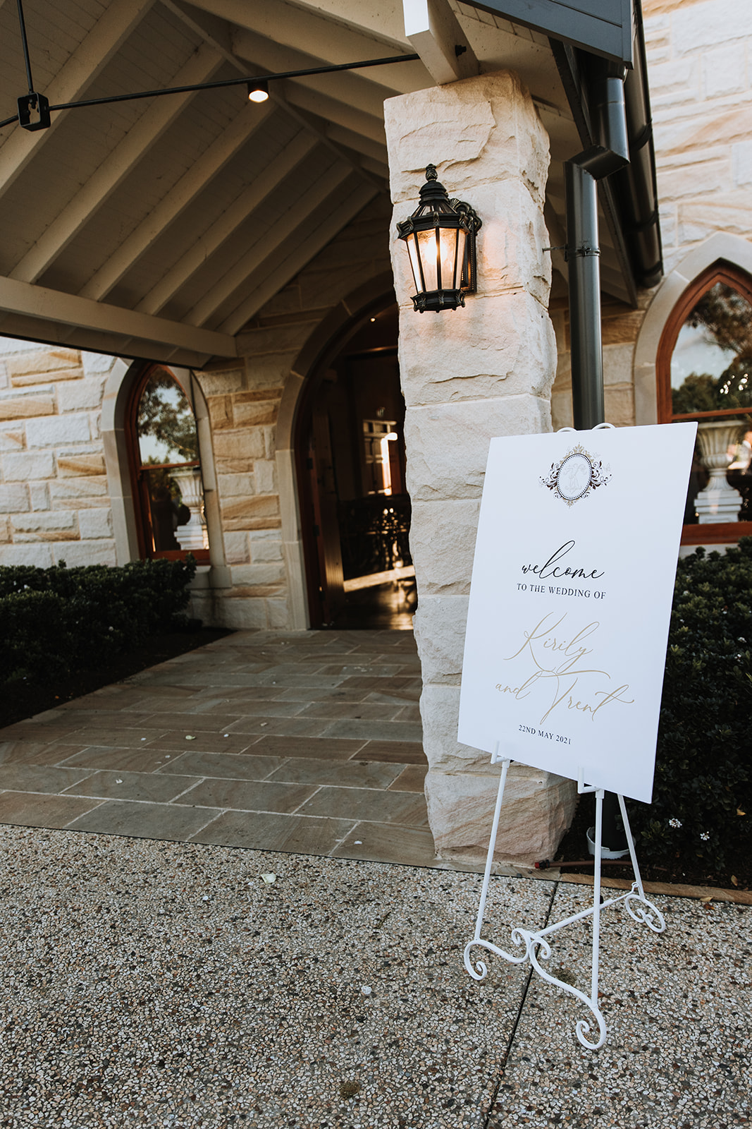 white and gold wedding welcome sign