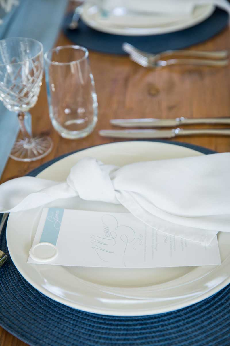 bathhouse winter wedding white and blue menu wax seal