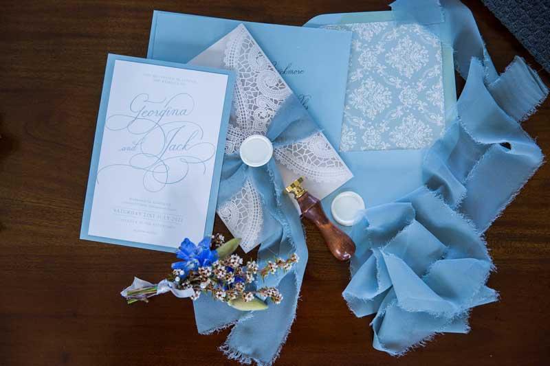 bathhouse winter wedding white and blue laser-cut wedding invitation suite