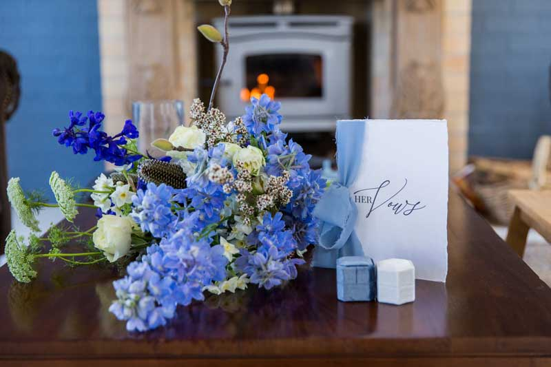 bathhouse winter wedding white and blue wedding vow book