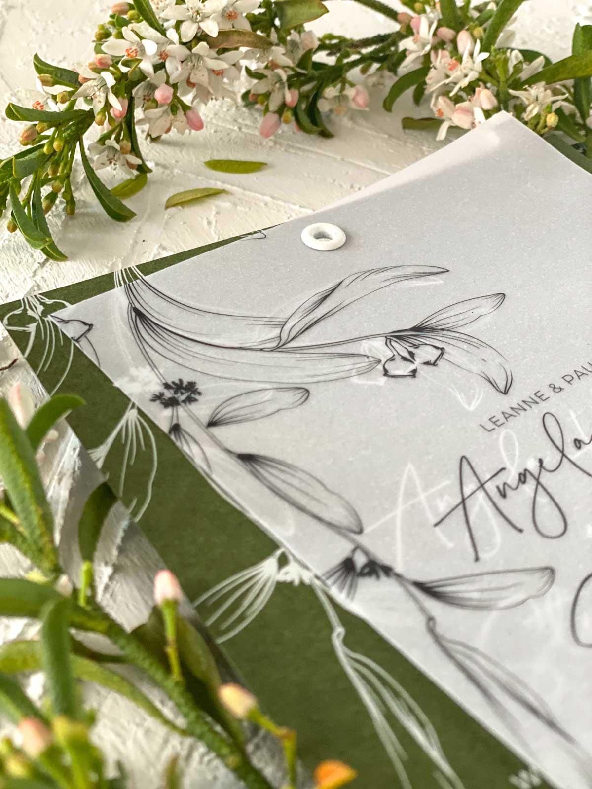 leaf green vellum wedding invitation eyelet closeup
