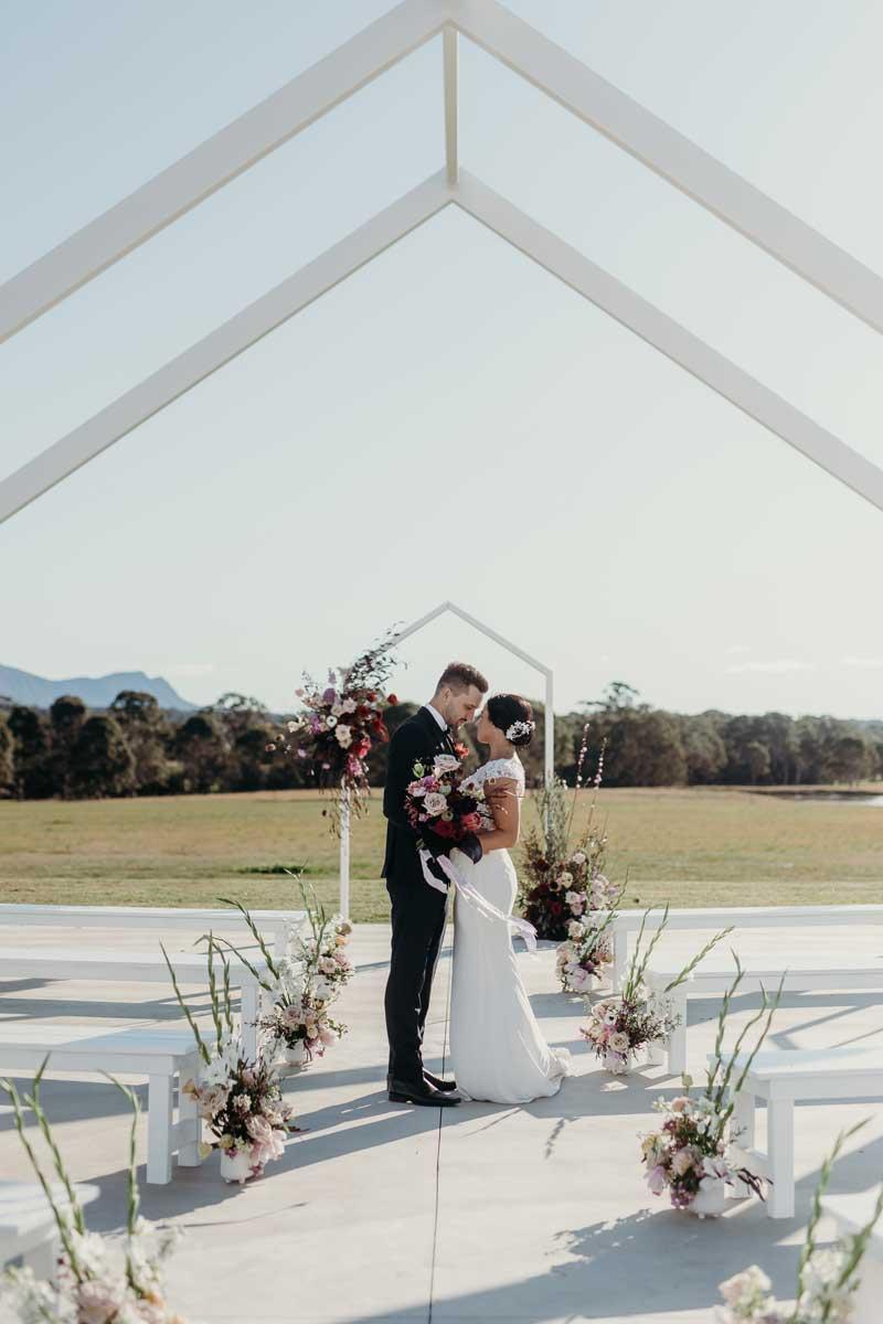 binet winery bridal wedding ceremony arch couple