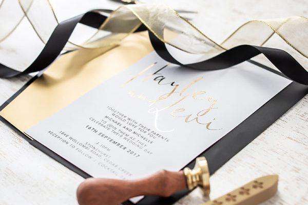 gold foil and black wedding invitation